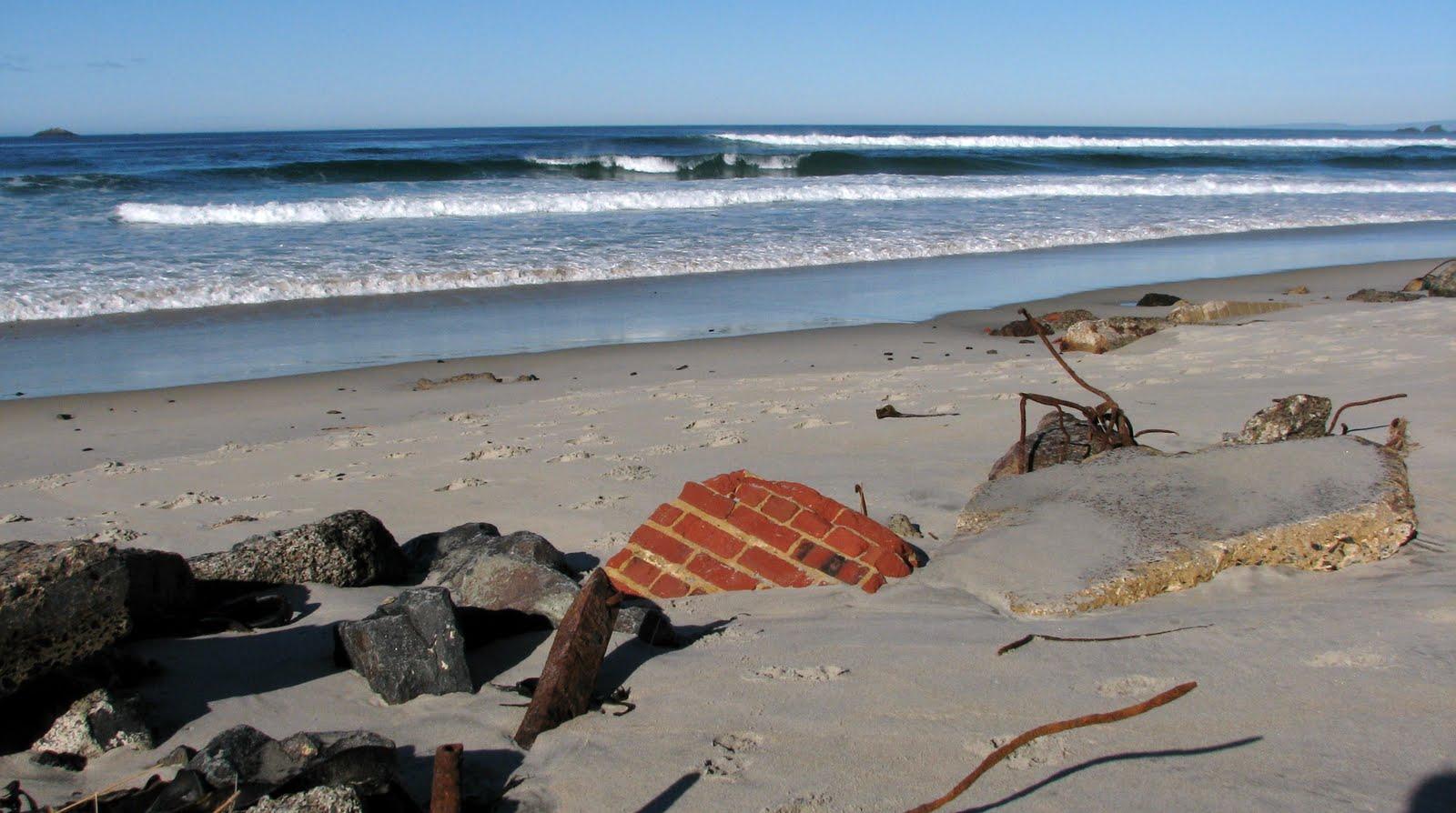brick wall remains on beach