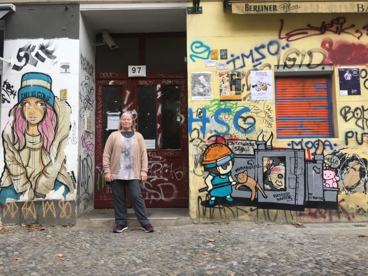 Me outside graffitti wall