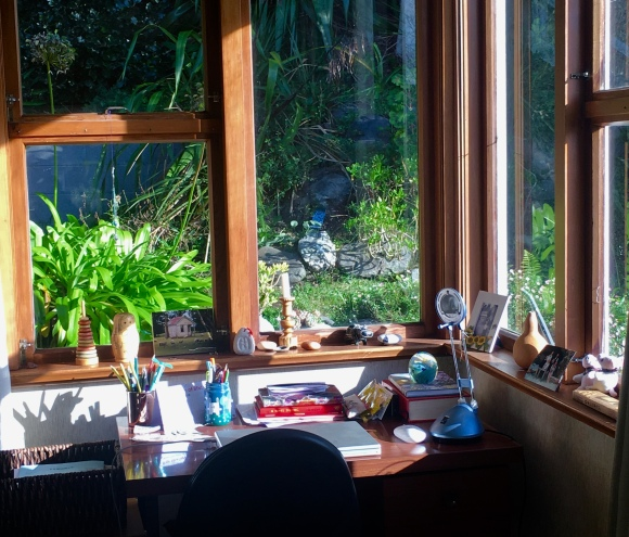 desk in window corner