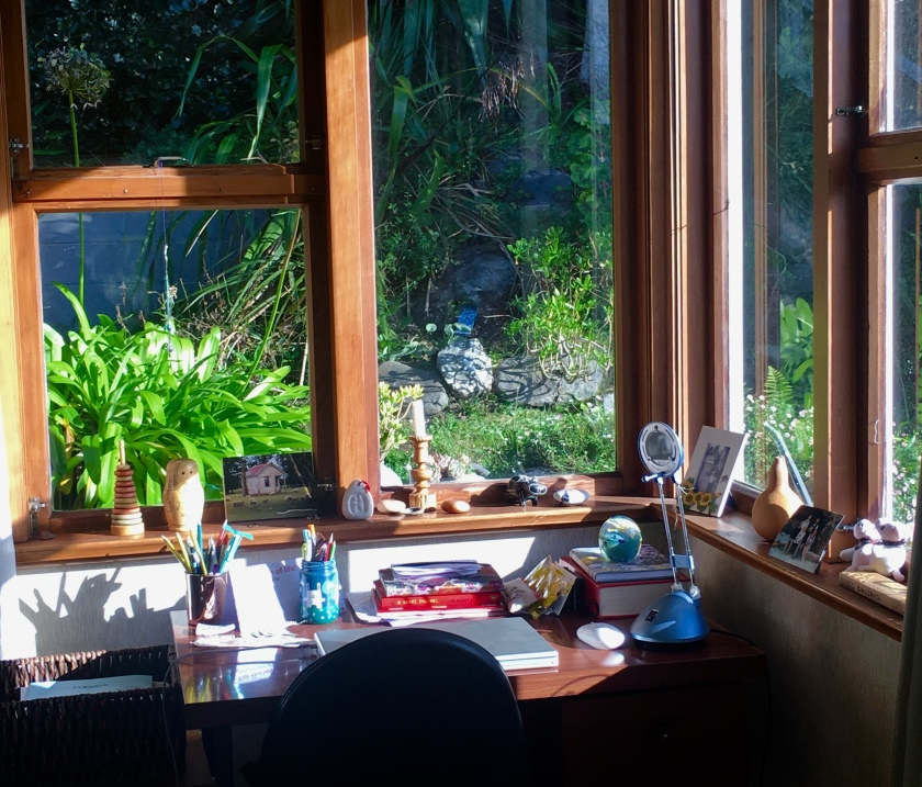 desk in window corner